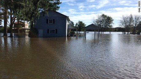 Reed says 2 feet of water has flooded his family's house in Snow Hill.