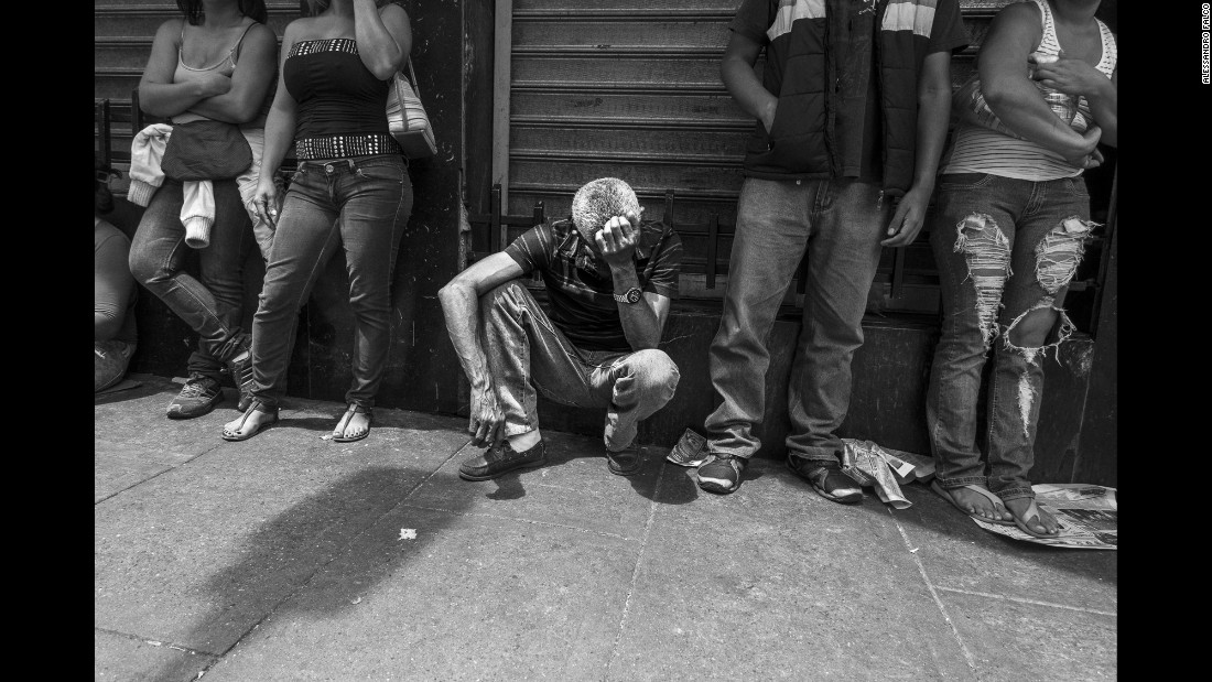 A man waits in line to buy some bread in the Chacao district of Caracas, Venezuela. The country is facing a severe economic crisis, and a large part of the population has no access to essential food products at a reasonable price.