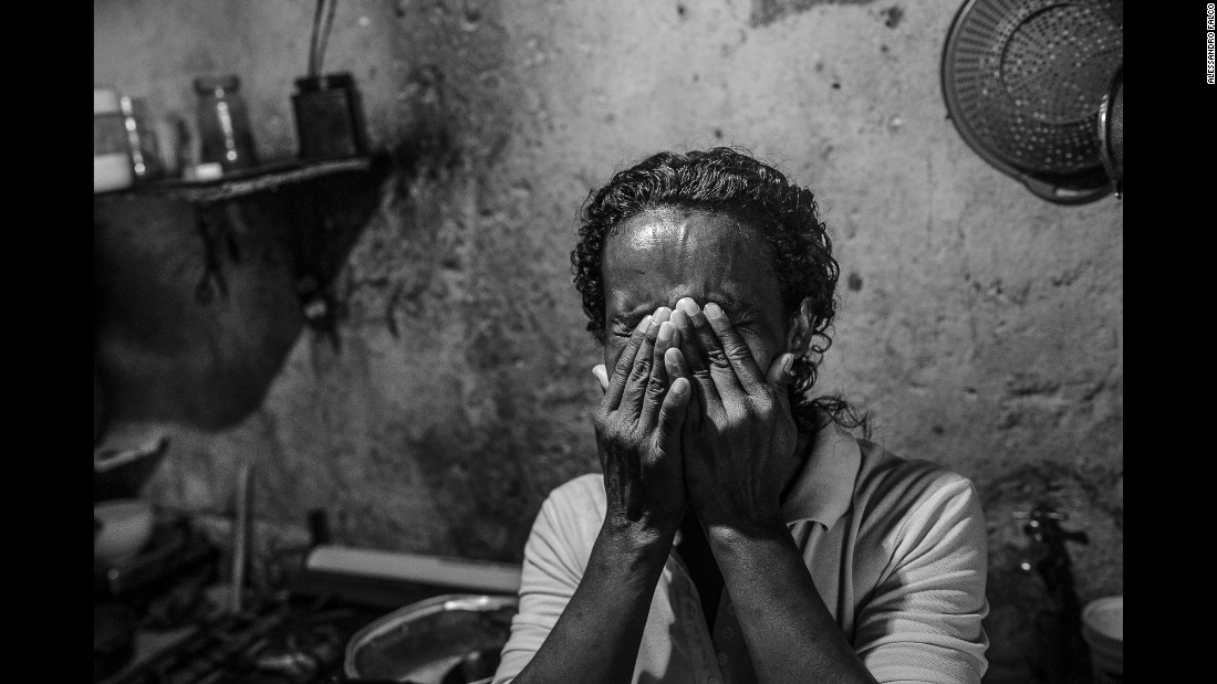 Paula, 48, bursts into tears as she recalls how life in Venezuela has changed in a few years. She is cooking chicken feet for lunch -- a meal she said she used to give to her dog.