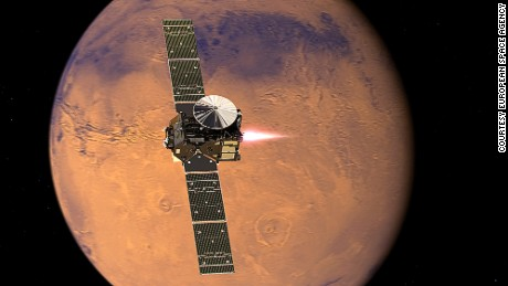 Artist's impression visualising the ExoMars 2016 Trace Gas Orbiter (TGO), with its thrusters firing, beginning its entry into Mars orbit on 19 October 2016