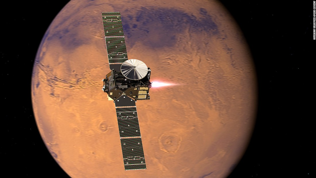 """<a href=""""http://exploration.esa.int/mars/46475-trace-gas-orbiter/"""" target=""""_blank"""">The ExoMars Trace Gas Orbiter </a>arrives will look for gases that could signal biological activity. Pictured, a representation of the orbiter beginning its entry into Mars orbit."""