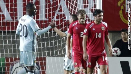 Benteke celebrates with teammate Dries Mertens at the Faro Municipal Stadium