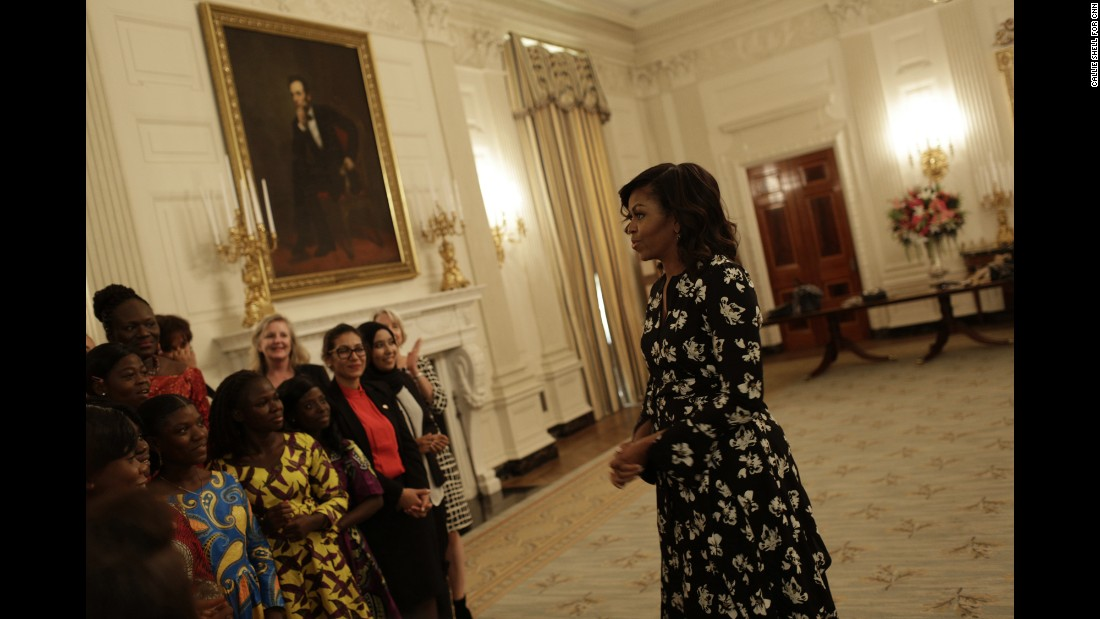 "As part of her effort to make an impact on global girls' education, Obama, seen here speaking to a group in the State Dining Room, <a href=""http://www.cnn.com/2016/07/01/opinions/africa-trip-michelle-obama/index.html"" target=""_blank"">launched an initiative called Let Girls Learn</a>. The program has partnered ""with some of the world's largest companies and organizations that are committing money, resources and expertise"" to girls' education, Obama wrote in her opinion piece."