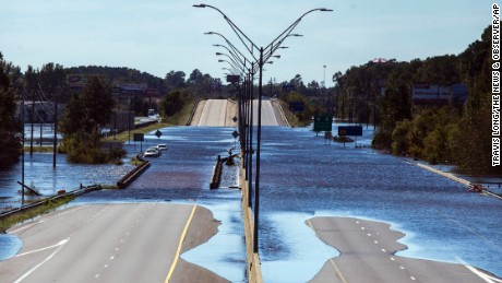 The Lumber River flows over Interstate 95 on Monday in Lumberton, North Carolina.