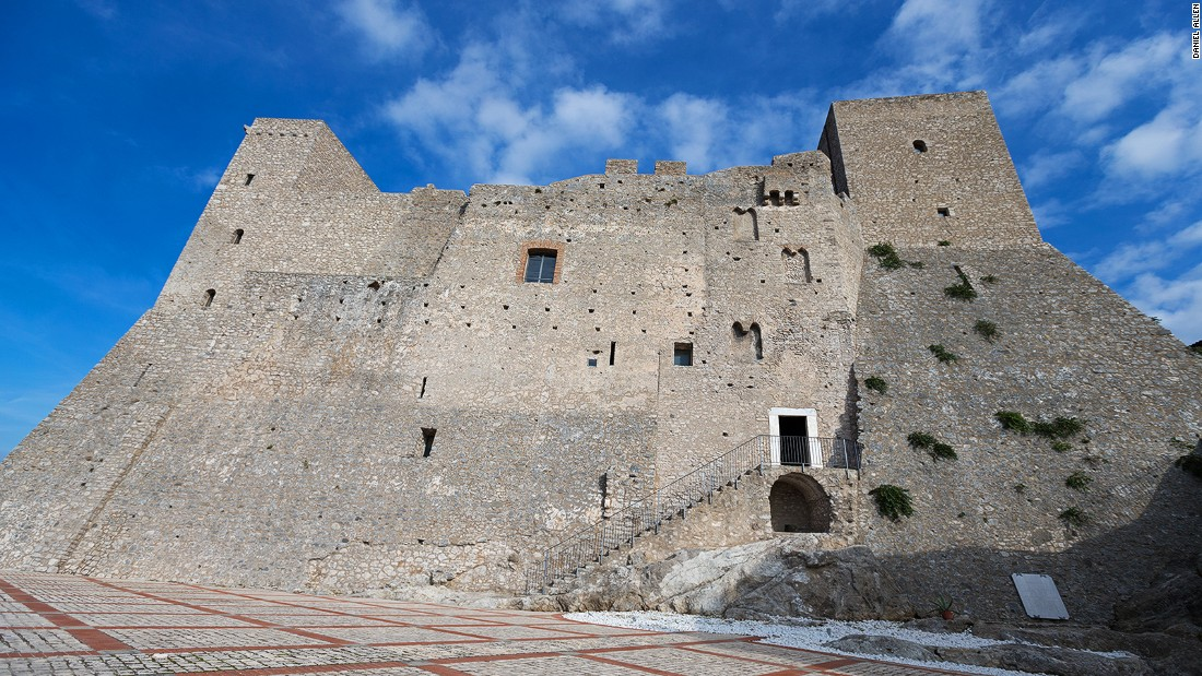 """A medieval castle built in about A.D. 880 -- and expanded at various times -- dominates the Itri skyline. Built as a fortress, it's surrounded by thick, crenelated walls. A lower cylindrical tower, connected to the main castle by an impressive wall-walk, is popularly known as """"the crocodile tower"""" because prisoners were apparently once fed to a ferocious reptile kept in its watery depths."""