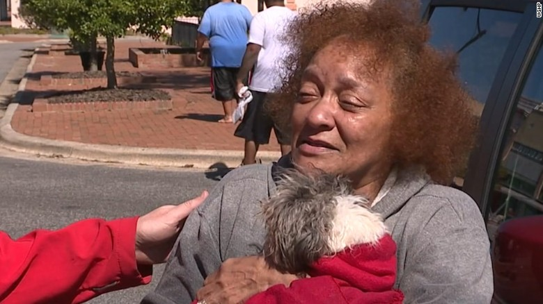Woman sobs after rescue from flooded home