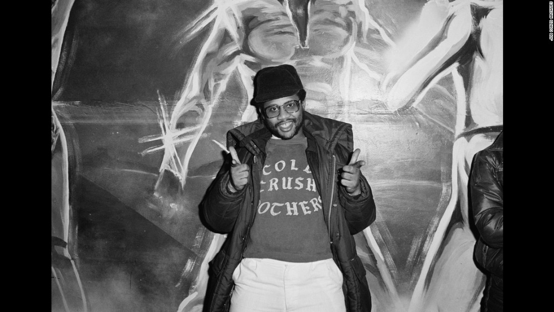 KK was part of the Cold Crush Brothers' security team. He's related to DJ Tony Tone, a founding member of the group. In the background is the famous space mural at the Harlem World club in New York.