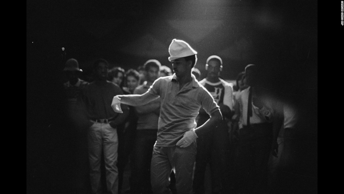 "A ""popper"" dances at the Roseland Ballroom in 1982. ""This is one of my most iconic pictures,"" Conzo said. ""In this shot, my flash did not go off. So I got the silhouette of the guy. Some of my most iconic shots were mistakes. That's the great thing about analog film photography."""