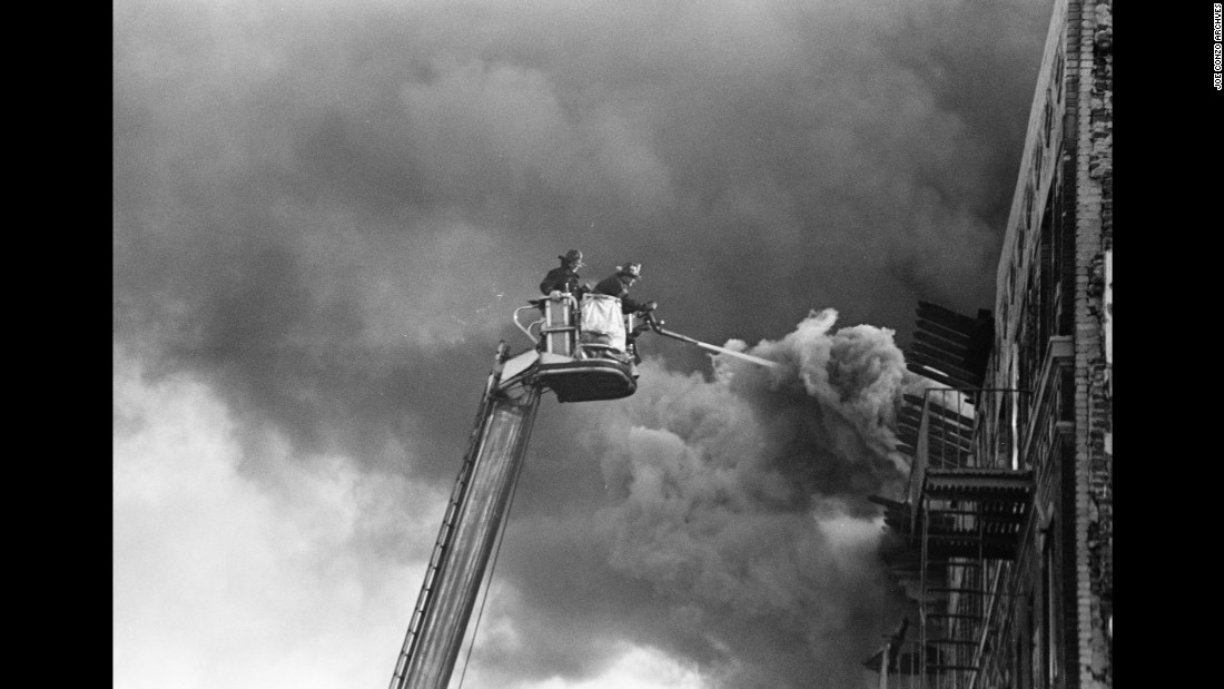 "A fire burns in the Bronx in 1980. ""I grew up in a time period where the Bronx was burning, so to speak,"" Conzo said. ""It's so funny how a lot of my images are of firefighters putting out fires in my neighborhood, and I end up working for the fire department 30 years later."""