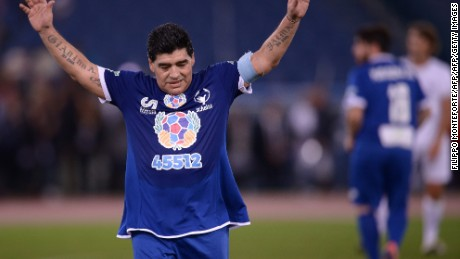Argentinian football legend Diego Armando Maradona waves to the crowd as he leaves the picth during the 'Match of Peace - United for Peace' charity football match promoted by the Schools for Encounter foundation at the Olympic stadium in Rome on October 12, 2016.  / AFP / FILIPPO MONTEFORTE        (Photo credit should read FILIPPO MONTEFORTE/AFP/Getty Images)