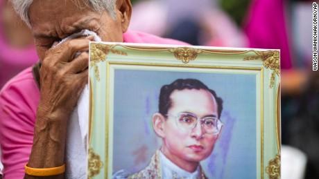 A woman prays for Thailand's King Bhumibol Adulyadej at Siriraj Hospital where the king was being treated in Bangkok, Thailand.