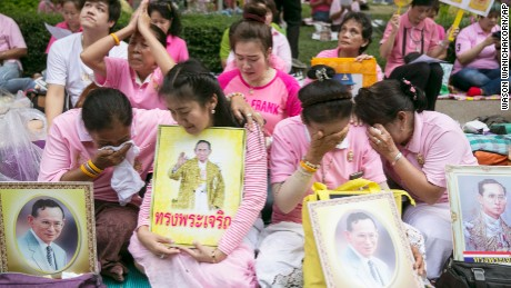 Thai people cry as they prayed for Thailand's King Bhumibol Adulyadej at Siriraj Hospital where the king was being treated in Bangkok, Thailand.