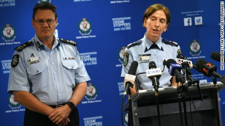 New South Wales Police Commissioner Catherine Burn, right, addresses the media after two 16-year-old boys were charged with terror-related offences in Sydney on October 13, 2016.