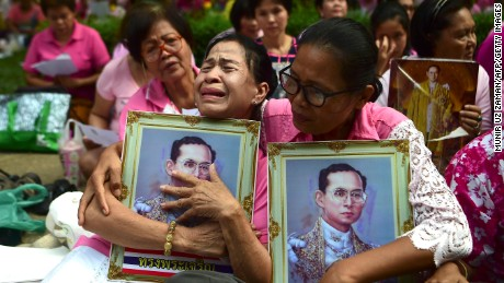 Supporters of Thailand's King Bhumibol Adulyadej react as they pray at Siriraj Hospital, where the king is being treated, in Bangkok on October 13, 2016. Well-wishers kept up their vigil outside a Bangkok hospital on October 13, offering prayers for ailing King Bhumibol Adulyadej as Thailand faces the prospect of losing its figure of unity in a deeply polarized nation. / AFP / MUNIR UZ ZAMAN        (Photo credit should read MUNIR UZ ZAMAN/AFP/Getty Images)