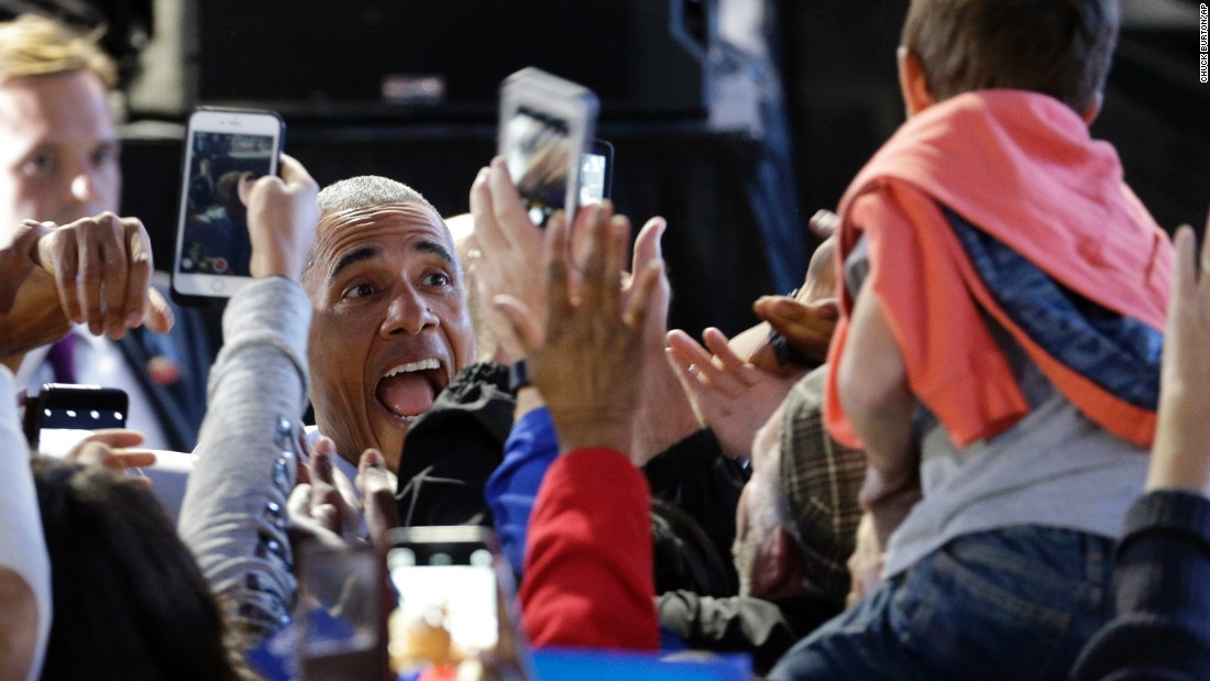 U.S. President Barack Obama greets supporters at a campaign rally for Hillary Clinton, Democratic presidential nominee, in Greensboro, North Carolina, on Tuesday, October 11.
