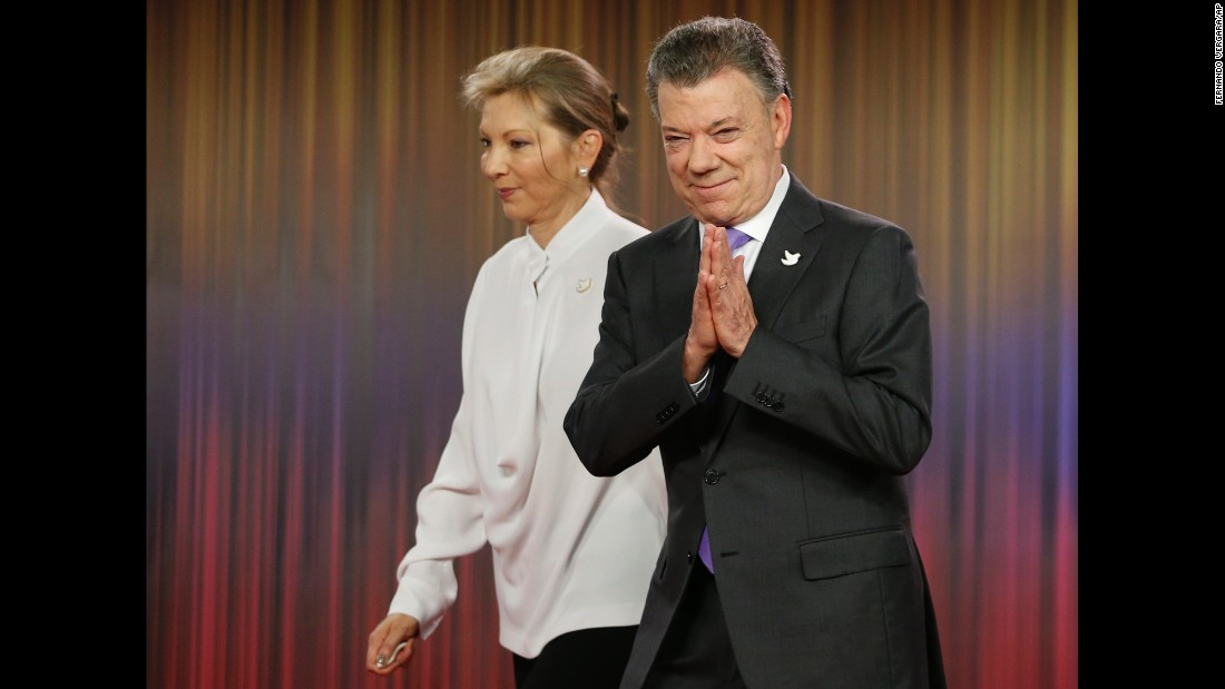 """Colombian President Juan Manuel Santos, right, arrives with his wife for a press conference at the presidential palace in Bogota, Colombia, on Friday, October 7. <a href=""""http://www.cnn.com/2016/10/07/world/nobel-peace-prize-2016/index.html"""" target=""""_blank"""">Santos won the Nobel Peace Prize</a> five days after <a href=""""http://edition.cnn.com/2016/10/02/americas/colombia-farc-peace-deal-vote/"""" target=""""_blank"""">Colombian voters narrowly rejected a peace deal</a> aimed at ending their country's 52-year-long civil war with the FARC rebel group."""