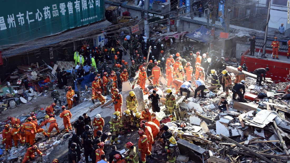 """Rescuers search for survivors after four residential buildings caved in early on the morning on Monday, October 10, in Wenzhou, China. <a href=""""http://www.cnn.com/2016/10/10/asia/china-building-collapse/"""" target=""""_blank"""">At least 22 people were killed</a> and it is unclear what caused the buildings to collapse."""
