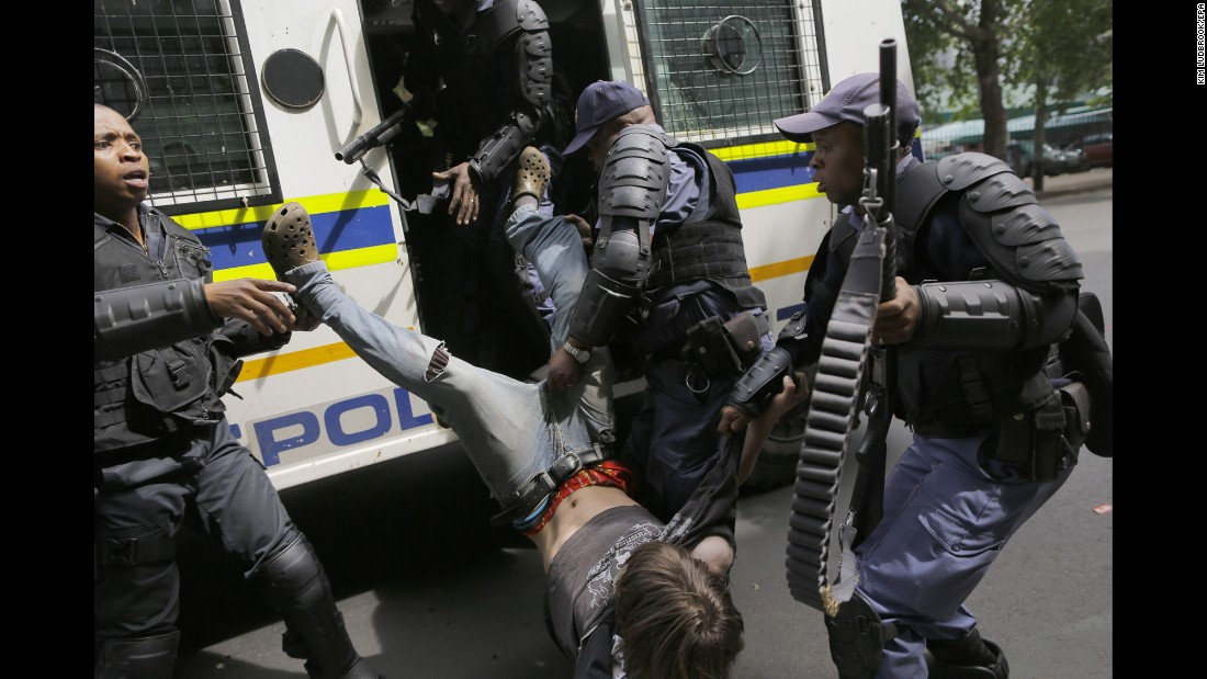 """A student from Wits University is arrested after clashes with police in Johannesburg on Monday, October 10. For more than a year, students across South Africa have been <a href=""""http://www.cnn.com/2016/10/11/africa/south-africa-student-protests/index.html"""" target=""""_blank"""">protesting against university fee increases</a>."""