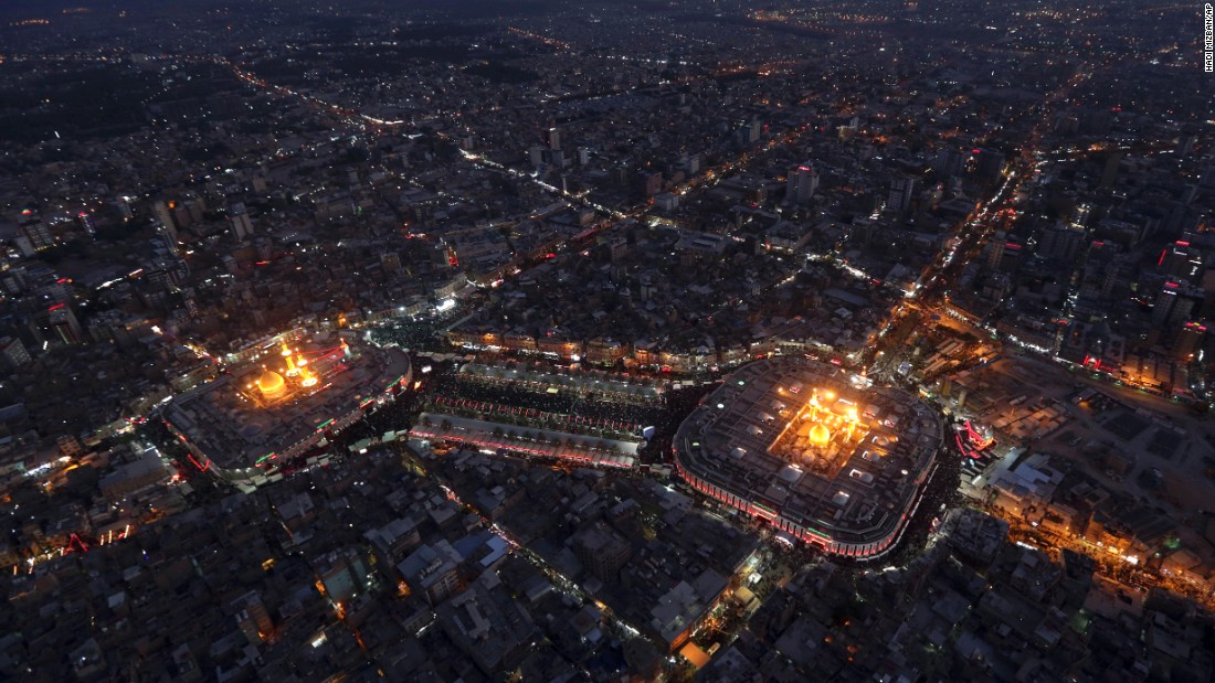"""Muslims gather in Karbala, Iraq, at the holy shrine of Imam Hussein and Imam Abbas during the month of Muharram on Tuesday, October 11. Muharram is an important period of mourning and marks the anniversary of the Battle of Karbala. <a href=""""http://www.cnn.com/2016/10/06/world/gallery/week-in-photos-1007/index.html"""" target=""""_blank"""">See last week in 29 photos</a>"""