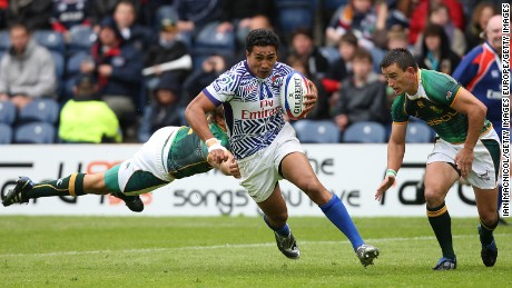 Reupena Levasa evades South African tacklers in Samoa's successful 2010 campaign.