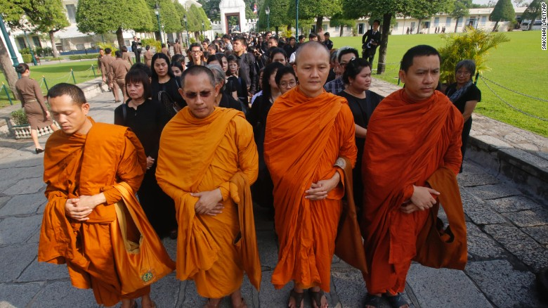 Buddhist monks and others line up to offer condolences for King Bhumibol Adulyadej at the Grand Palace in Bangkok, Thailand, Friday, October 14.