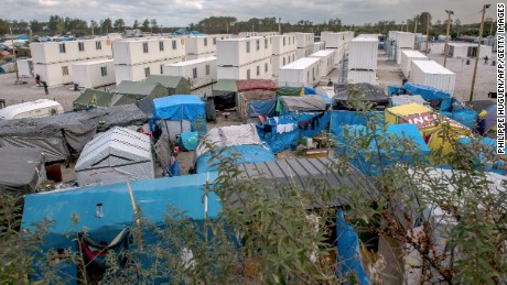 "A photo shows a view of the ""Jungle"" migrant camp in Calais on October 12, 2016. French authorities are preparing to raze the Calais ""Jungle"" camp and move thousands of migrants to shelters nationwide. / AFP / PHILIPPE HUGUEN        (Photo credit should read PHILIPPE HUGUEN/AFP/Getty Images)"