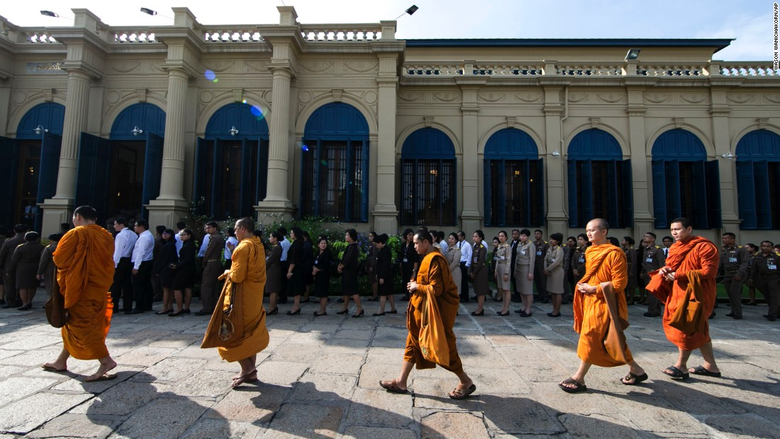 Buddhist monks line up to offer condolences at the Grand Palace in Bangkok on Friday.