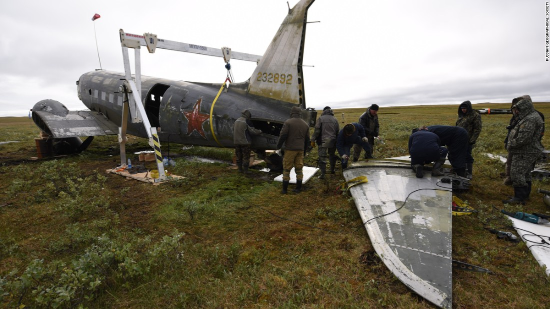 The Douglas C-47 was cut in pieces -- fuselage, wings, engines and central section -- so that a Mi-8 helicopter could lift and deposit them on a barge that had been brought to the nearby Pyasina River.