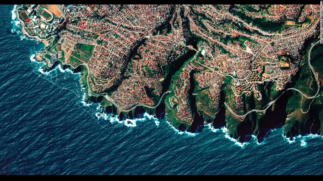 """Valparaiso, Chile, is built upon dozens of steep hillsides overlooking the Pacific Ocean, and the city is known as """"The Jewel of the Pacific."""" This is one of the satellite images from Benjamin Grant's upcoming book, """"Overview: A New Perspective of Earth."""""""