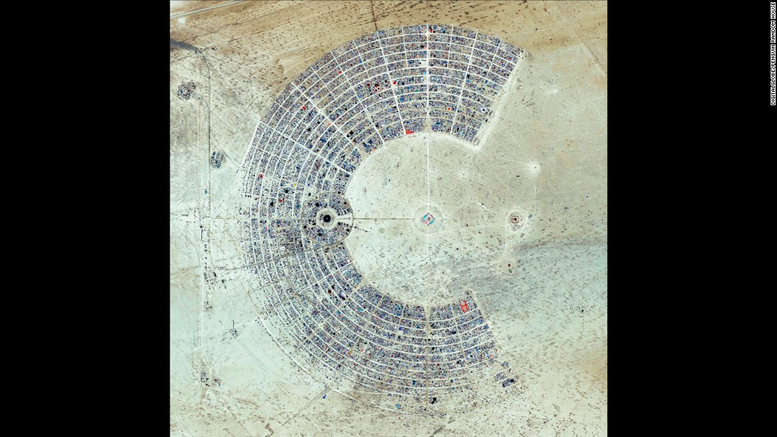 """A satellite view of Burning Man, an annual event held in the Black Rock Desert of Nevada. The gathering is described as an experiment in community, art, self-expression and radical self-reliance. One of its key principles is """"Leave No Trace,"""" as significant efforts are taken to make sure the desert returns to its original state in the days following the festival."""