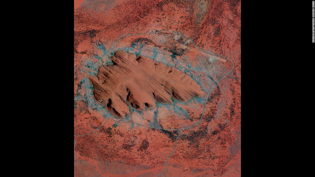 Uluru, or Ayers Rock, is a large sandstone formation in the Northern Territory of Australia. The monolith -- towering 1,141 feet high with an expanse of 2.2 miles by 1.2 miles -- is a sacred site to the Aboriginal people of the area who first settled there 10,000 years ago.