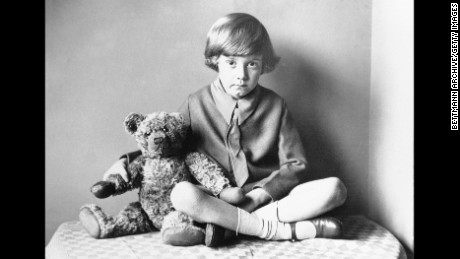 Author A.A. Milne's son, Christopher Robin sitting at home with the original Pooh Bear