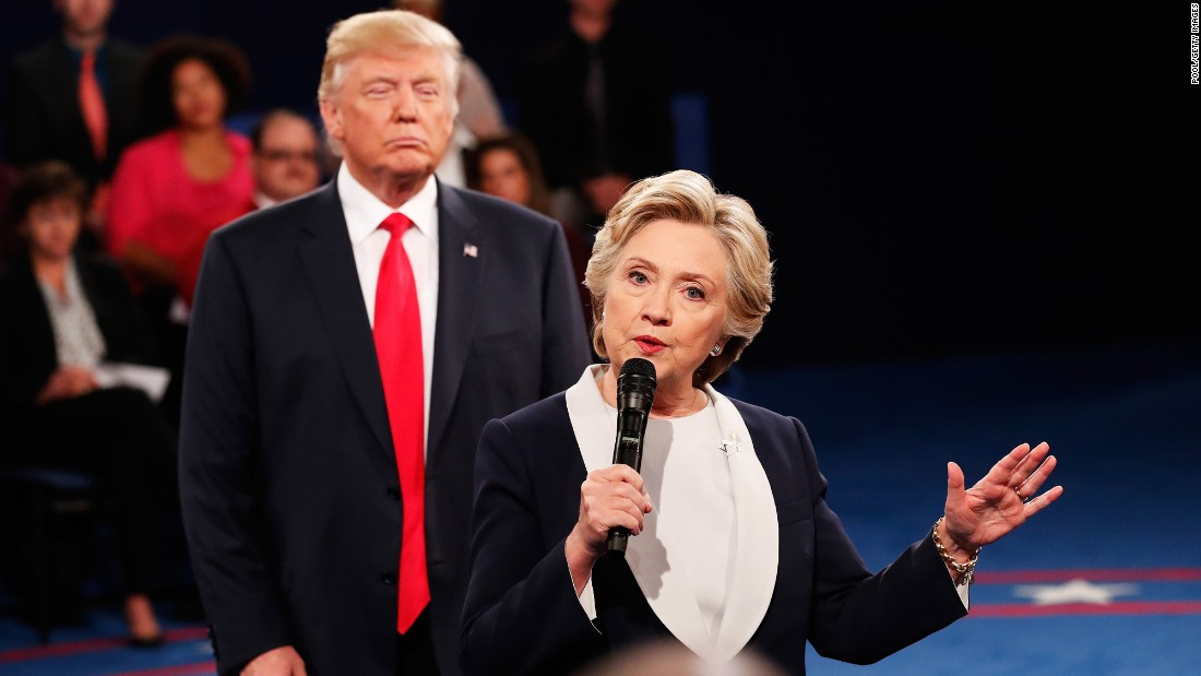 """Democratic presidential nominee Hillary Clinton speaks as Donald Trump, the Republican nominee, looks on during the <a href=""""http://www.cnn.com/2016/10/10/opinions/clinton-trump-second-debate-roundup/index.html"""" target=""""_blank"""">second presidential debate</a> in St. Louis, Missouri, on Sunday, October 9. Trump and Clinton clashed on a <a href=""""http://www.cnn.com/2016/10/09/politics/debate-fact-check-trump-clinton/"""" target=""""_blank"""">range of issues</a>."""