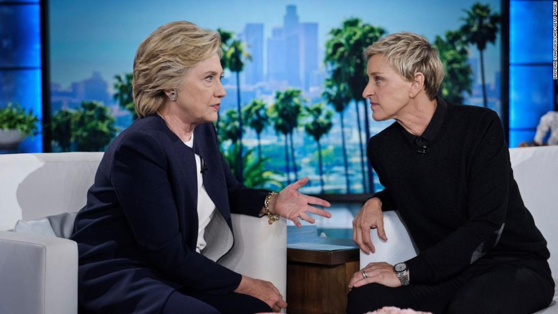 "Democratic presidential nominee Hillary Clinton, left, talks with television host Ellen DeGeneres during a commercial break on ""The Ellen DeGeneres Show"" in Burbank, California, on Thursday, October 13."