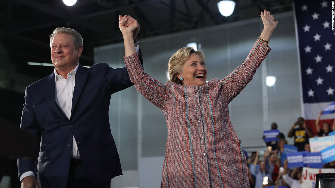 """Democratic presidential nominee Hillary Clinton, right, attends a campaign rally with former Vice President Al Gore in Miami on Tuesday, October 11. The two focused on <a href=""""http://www.cnn.com/2016/10/11/politics/hillary-clinton-al-gore-climate-change-2016-election/"""" target=""""_blank"""">climate change</a>, with Gore assuring the crowd that Clinton """"will make solving the climate crisis a top national priority."""""""