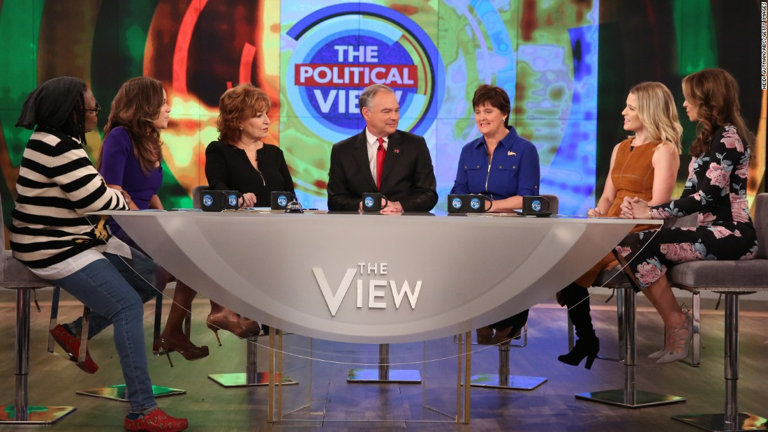 """Democratic vice presidential nominee Tim Kaine, center, appears with his wife Anne Holton, third from right, on the television show """"The View"""" in New York on Thursday, October 13."""