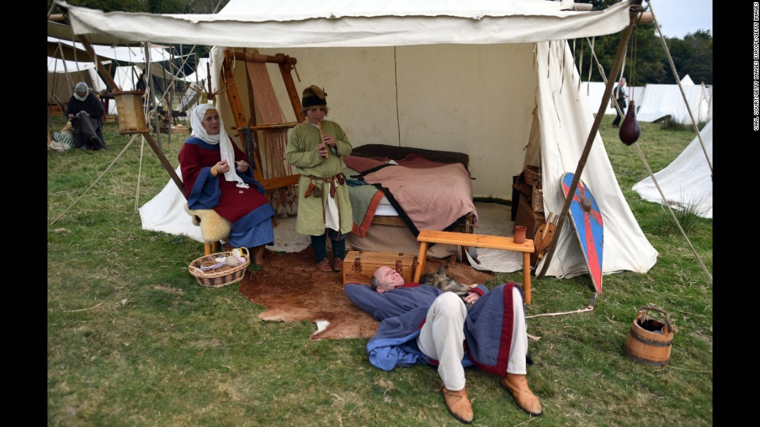 Participants relax ahead of the battle re-enactment.