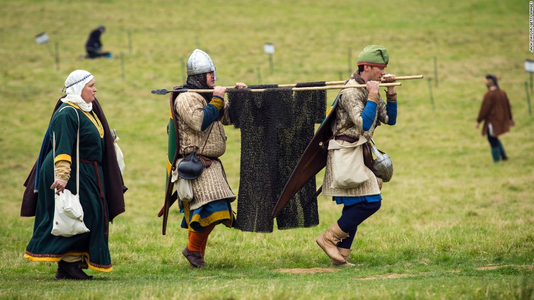 Re-enactors carry chain mail as they prepare to take part in battle on Saturday, October 15.