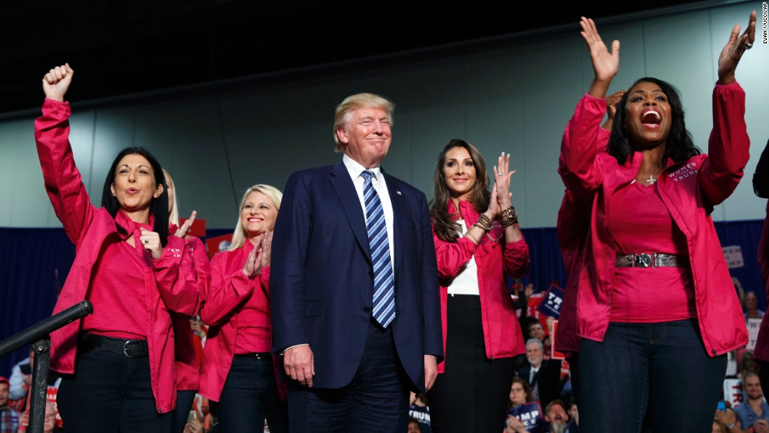 Republican presidential candidate Donald Trump stands on stage with female supporters during a campaign rally Friday, October 14, in Charlotte, North Carolina.