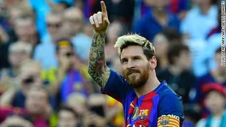 Lionel Messi celebrates scoring on his return from injury.