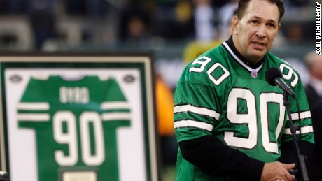 CORRECTS AGE TO 50 - FILE - In this Sunday, Oct. 28, 2012, file photo, former New York Jets player Dennis Byrd speaks during a halftime ceremony to retire his number during the second half of an NFL football game between the Jets and the Miami Dolphins, in East Rutherford, N.J. Byrd, the former NFL defensive lineman whose career was ended by neck injury, was killed Saturday, Oct. 15, 2016, in a car accident. He was 50. The Oklahoma Highway Patrol said Byrd, a former college player at Tulsa, was killed in a two-vehicle collision on Oklahoma 88, north of Claremore. (AP Photo/John Minchillo, File)