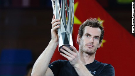 Andy Murray poses with trophy after beating Roberto Bautista Agut of Spain in the final of the Shanghai Masters.