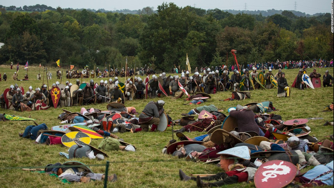 Re-enactors pretend to be dead on the battlefield. King Harold was among the thousands who died in the 1066 conflict.
