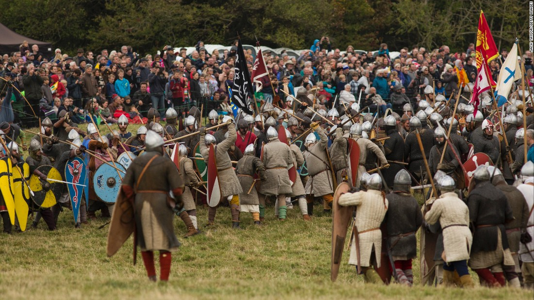 """Hundreds of re-enactors engage in """"battle"""" as crowds watch the action."""