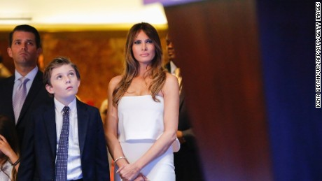 Melania and Barron Trump listen from the wings as Donald Trump announces he will run for the US presidency.