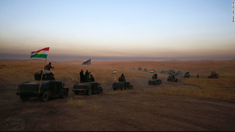 A Peshmerga convoy drives towards a frontline in Khazer, about 30 kilometers (19 miles) east of Mosul, Iraq,  on Monday, October 17, 2016.   The Iraqi military and the country's Kurdish forces say they launched operations to the south and east of militant-held Mosul early Monday morning.