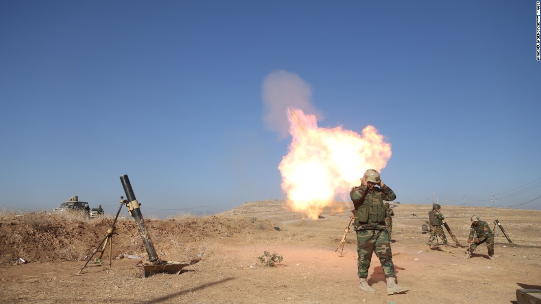 Peshmerga forces attack ISIS militants with howitzers from Zardak mountain on October 17.