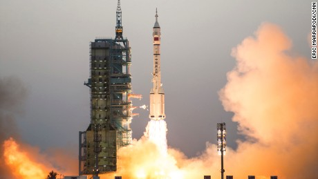 China's Shenzhou 11 spaceship onboard a Long March-2F carrier rocket takes off from the Jiuquan Satellite Launch Center in northwest China's Gansu province on Monday Oct. 17, 2016.