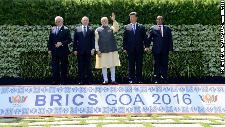 Brazilian President Michel Temer, Russian President Vladimir Putin, Indian Prime Minister Narendra Modi, Chinese President Xi Jinping and South African President Jacob Zuma pose for a group photo during the BRICS Summit in Goa on October 16, 2016.