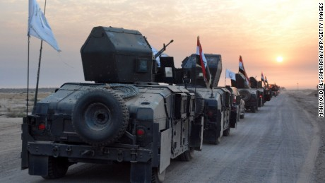 Pro-government forces drive in military vehicles in Iraq's eastern Salaheddin province, south of Hawijah, on October 10, 2016, as they clear the area in preparation for the push to retake the northern Iraqi city of Mosul, the last Islamic State (IS) group held city in Iraq.